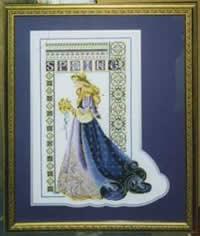 Cross stitch of a woman
